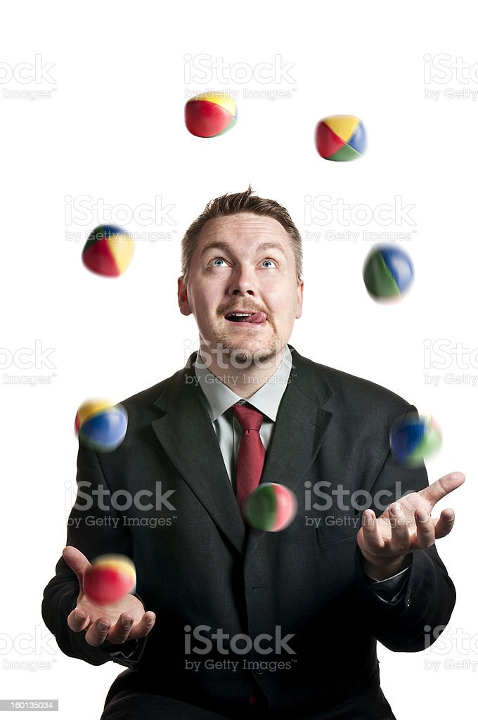 Businessman juggling royalty-free stock photo