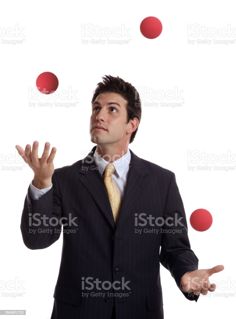 Businessman Juggling Red Balls stock photo