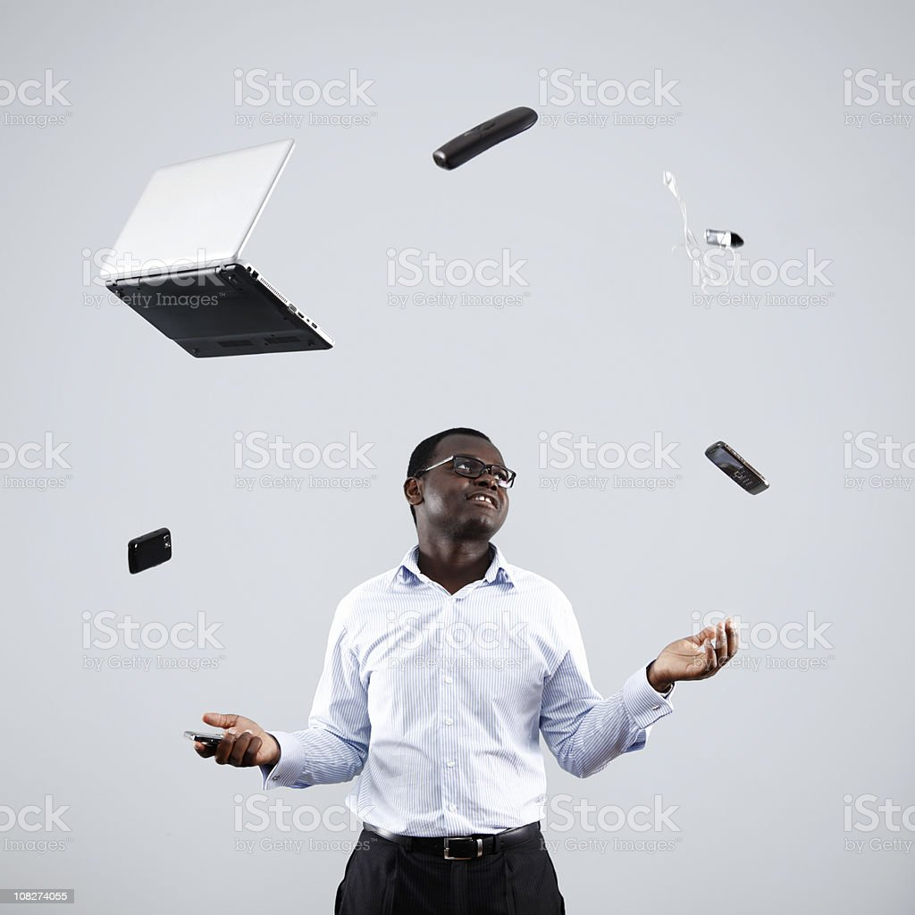 Businessman Juggling Technology stock photo