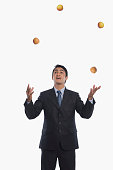 Businessman juggling with apples