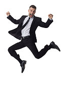 Businessman jumping and celebrating success