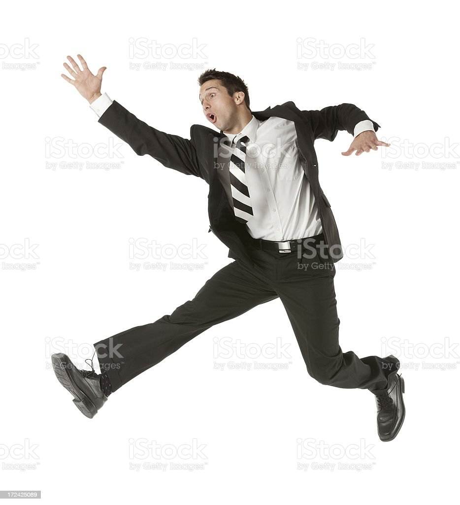 Businessman jumping and running royalty-free stock photo