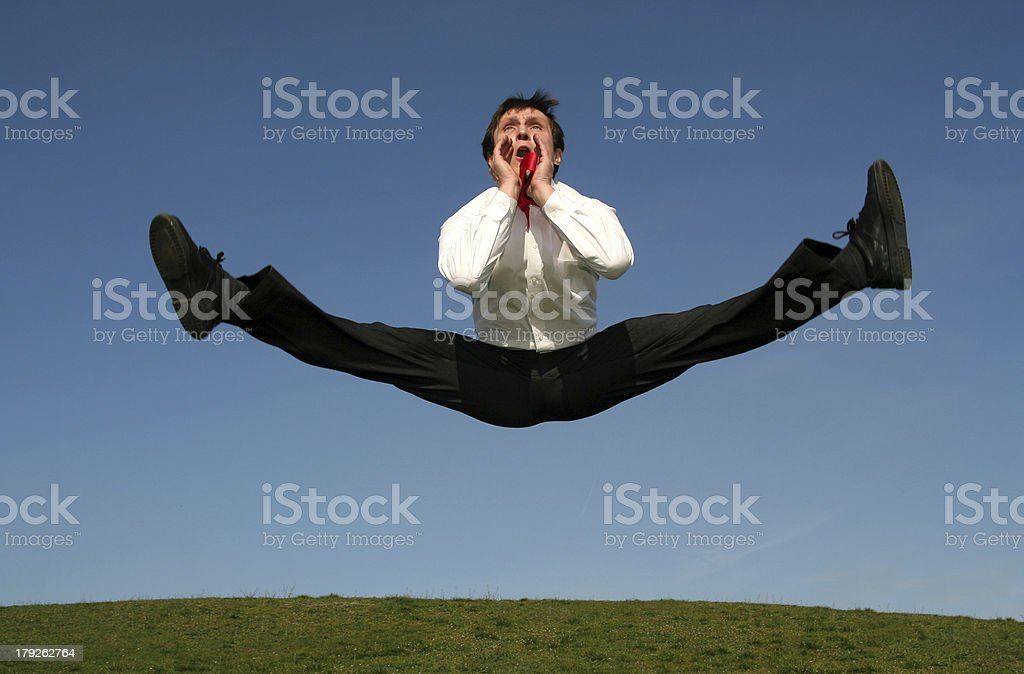 Businessman jumping and shouting royalty-free stock photo