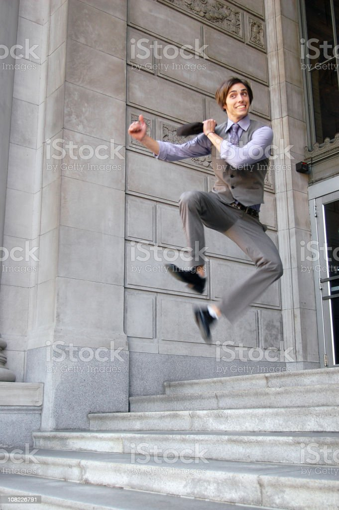 Businessman Jumping in Air royalty-free stock photo