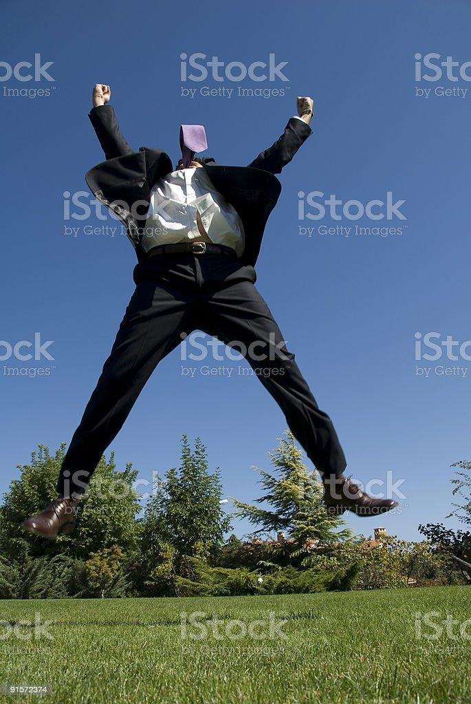 Businessman jumping in air raising arms, Zekeriyaköy, Istanbul, Turkey royalty-free stock photo