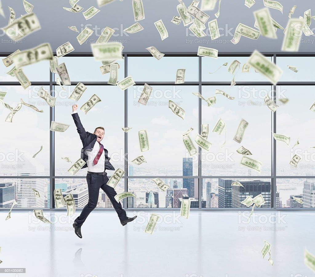 businessman jumping, money rain stock photo