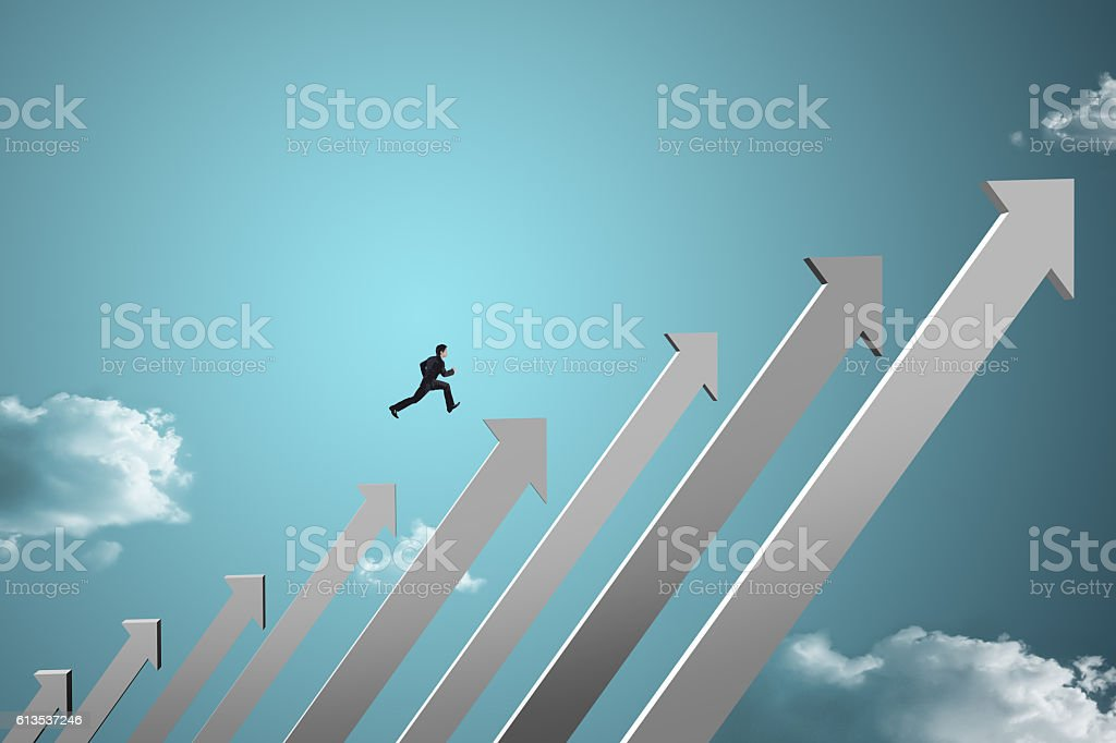businessman jumping on growing chart with sky background stock photo