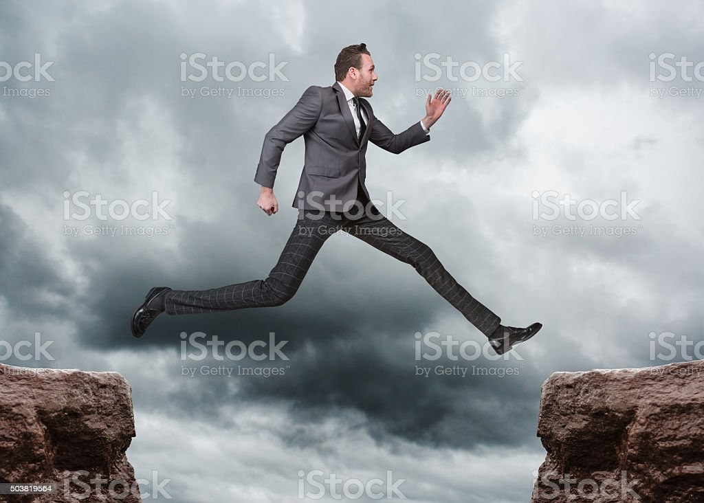 Businessman Jumping Outdoors stock photo