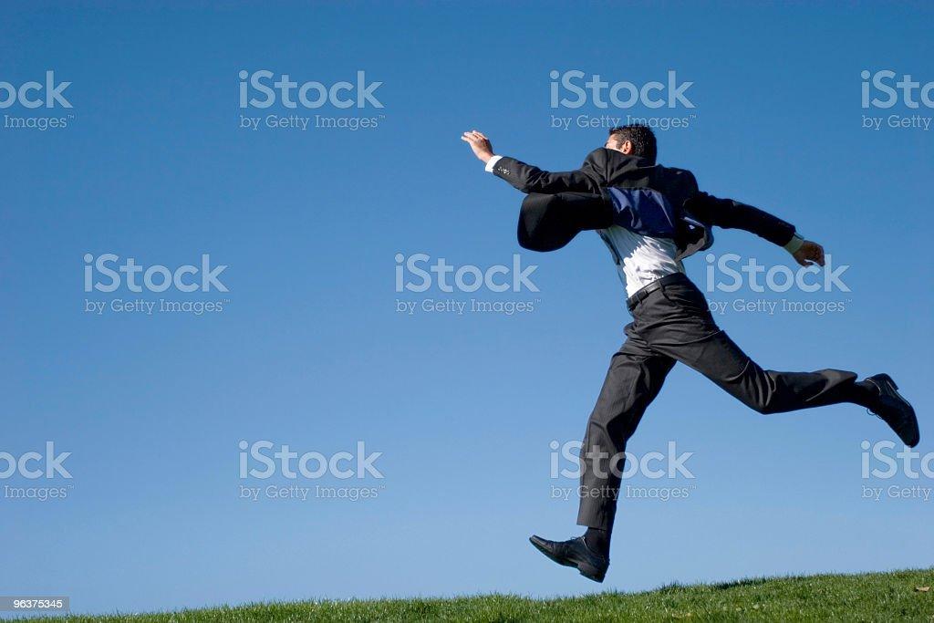Businessman jumping royalty-free stock photo