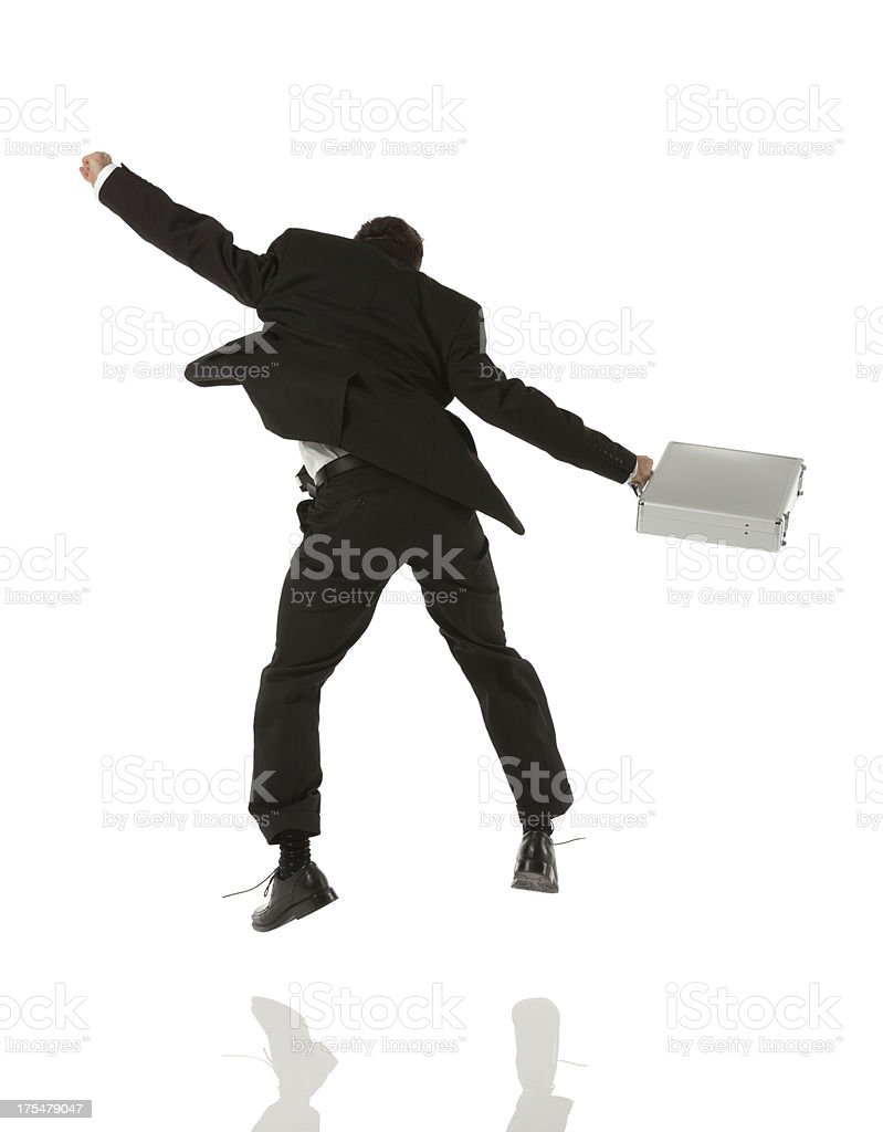Businessman jumping with a briefcase royalty-free stock photo
