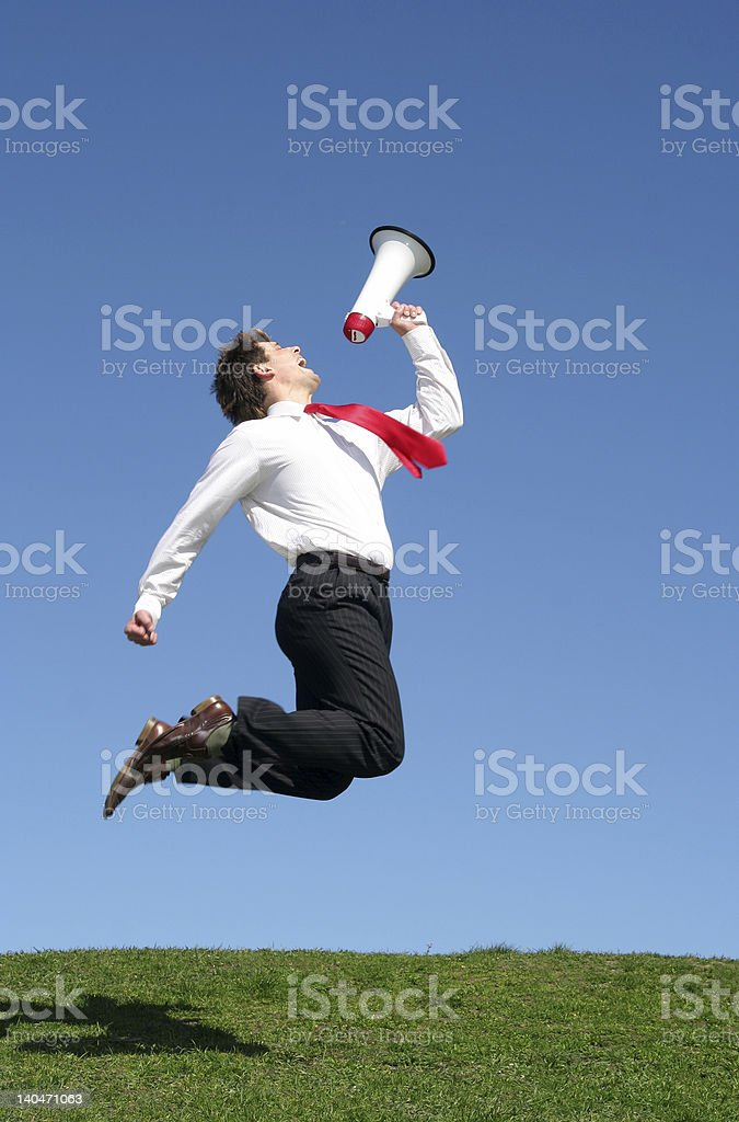 Businessman Jumping with Megaphone royalty-free stock photo