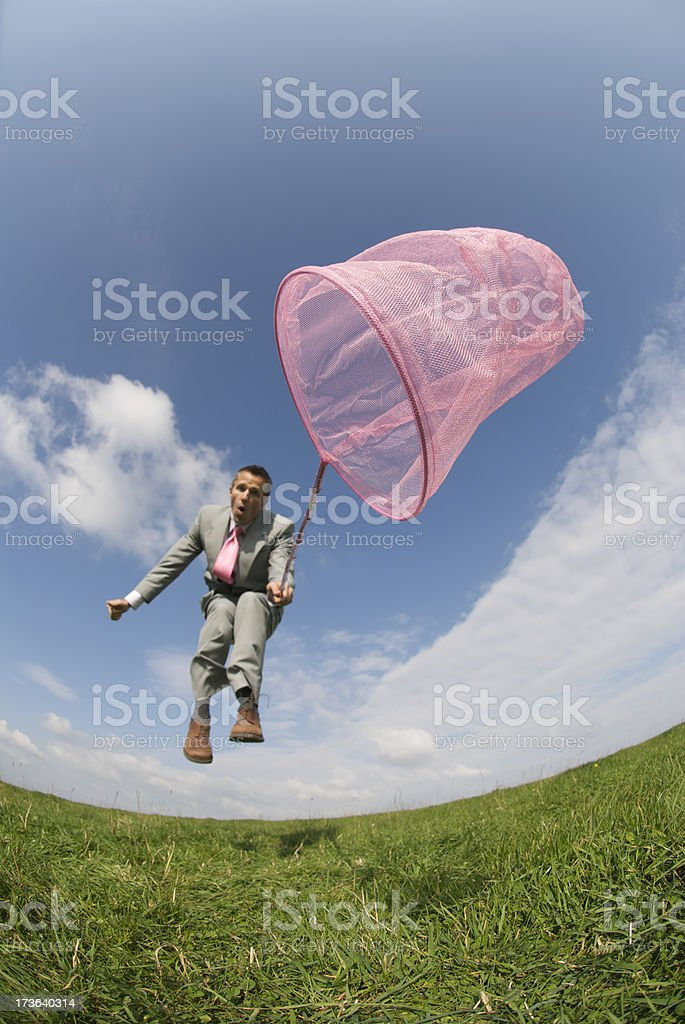 Businessman Jumps with Pink Butterfly Net royalty-free stock photo