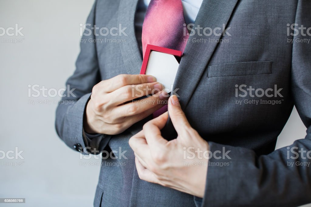 Businessman keeping house as collateral - unpaid and seized concept stock photo