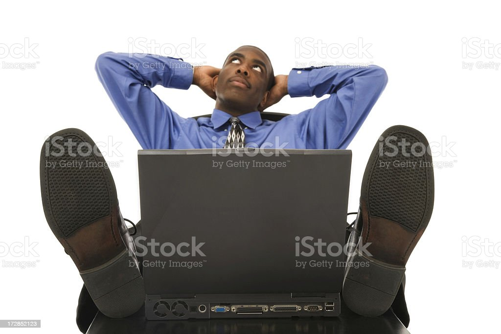 Businessman Kicking Back stock photo