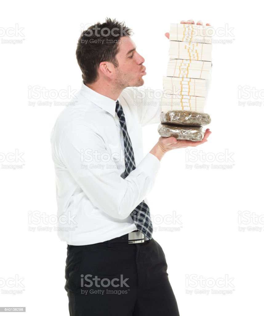 Businessman kissing on drug and money stock photo