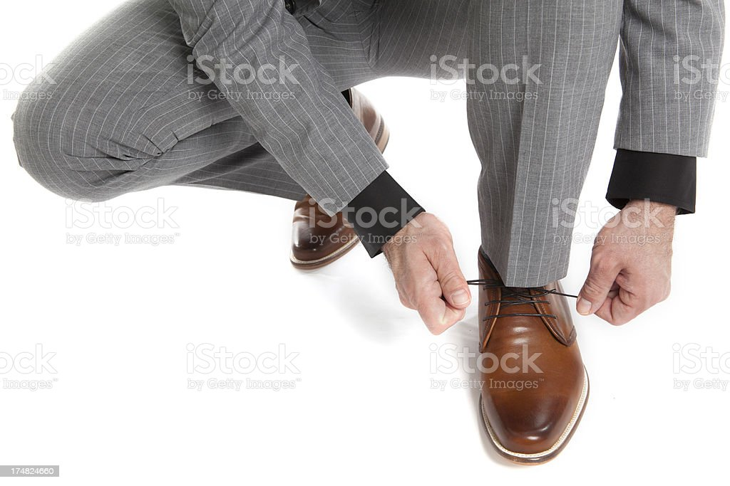 businessman lacing his shoes royalty-free stock photo