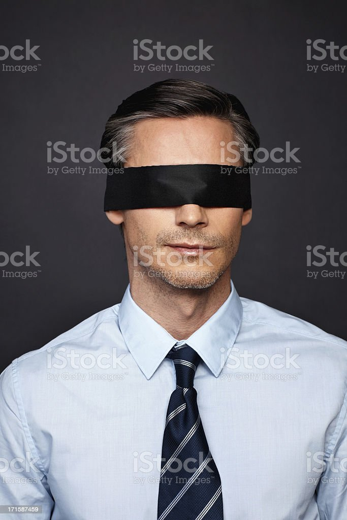 Businessman lacking vision stock photo