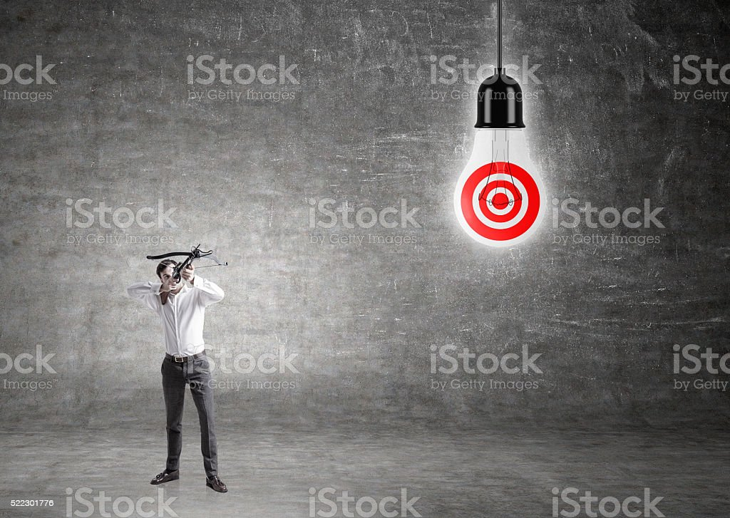 Businessman lamp with target stock photo