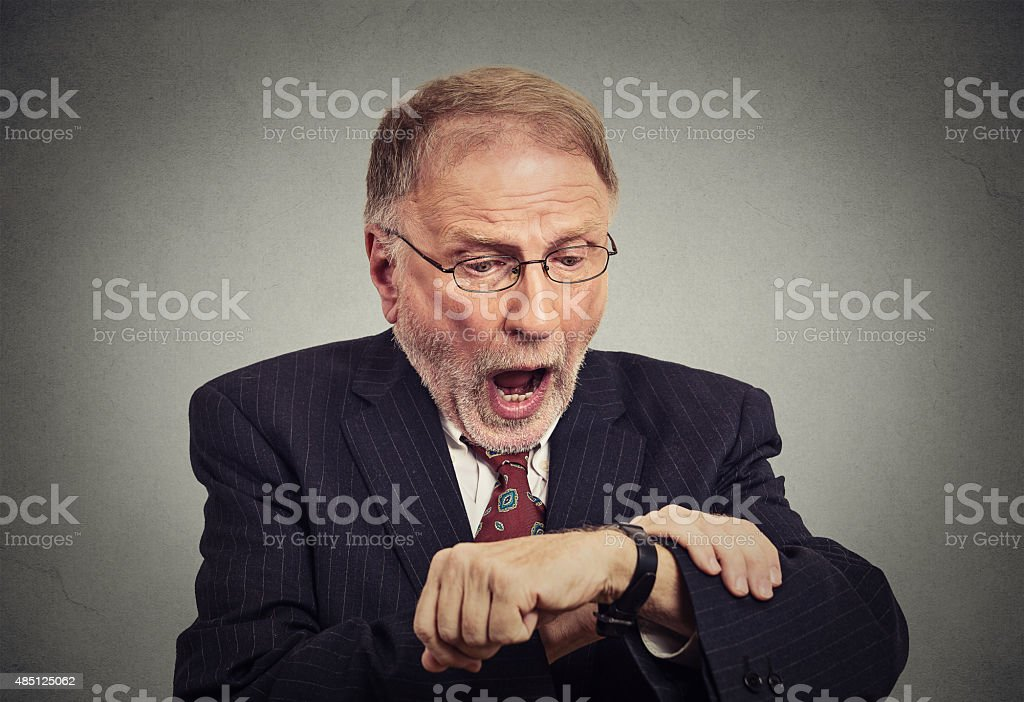 Businessman late for work stock photo