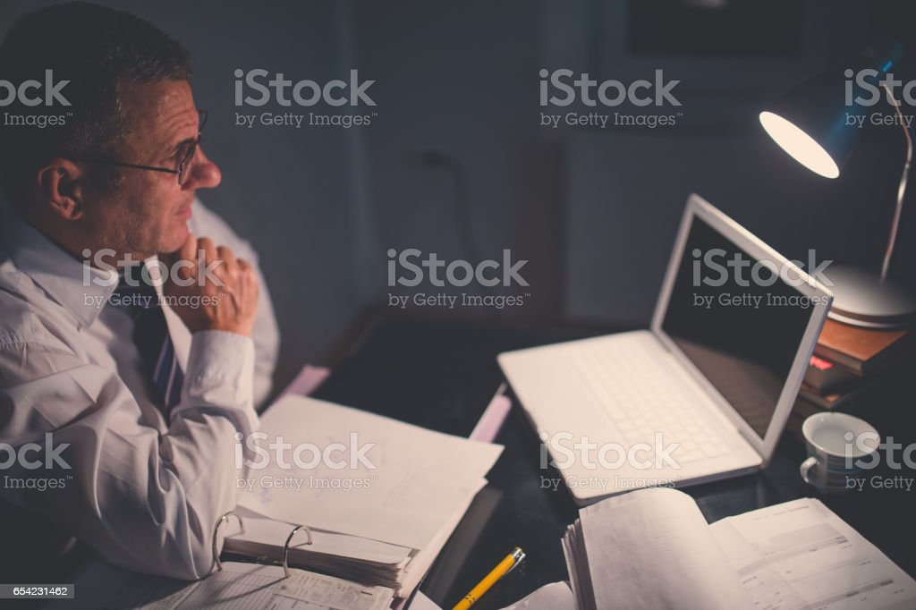 Businessman late in office stock photo