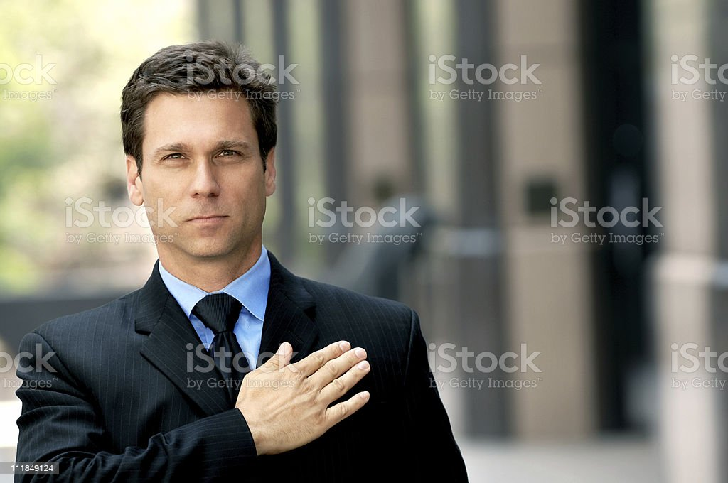 Businessman Lawyer with hand on heart stock photo
