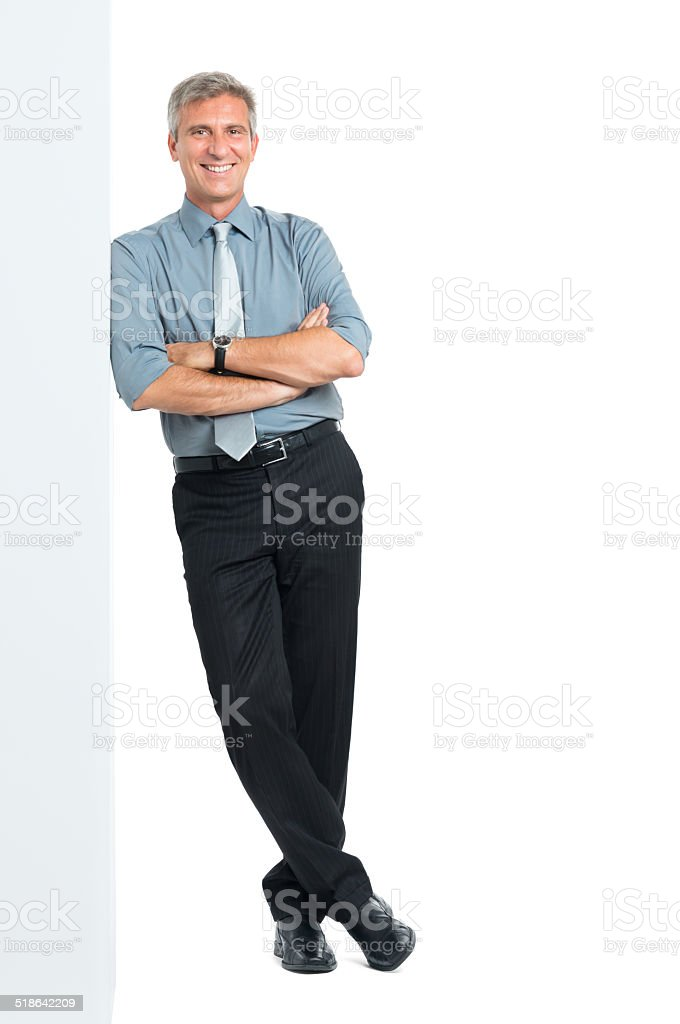 Businessman Leaning Against Sign stock photo