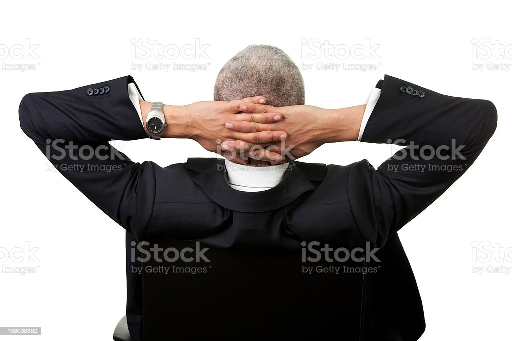 Businessman leaning back in the chair royalty-free stock photo