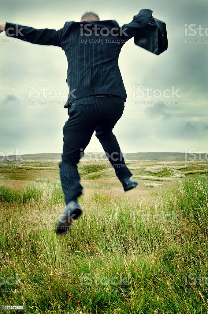businessman leaping royalty-free stock photo