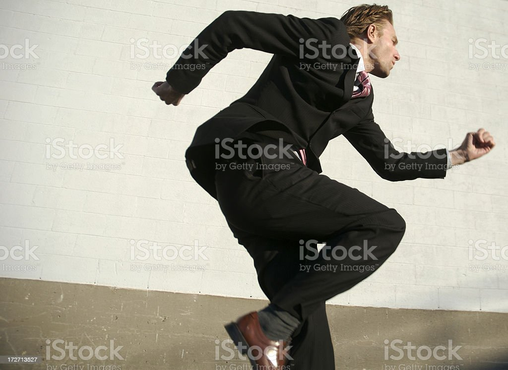 Businessman Leaps Across Frame royalty-free stock photo