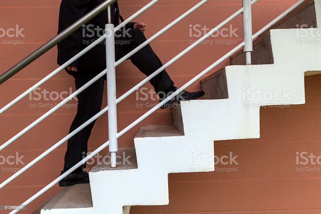 businessman leaps on stair, big step, raise fast, up, high stock photo