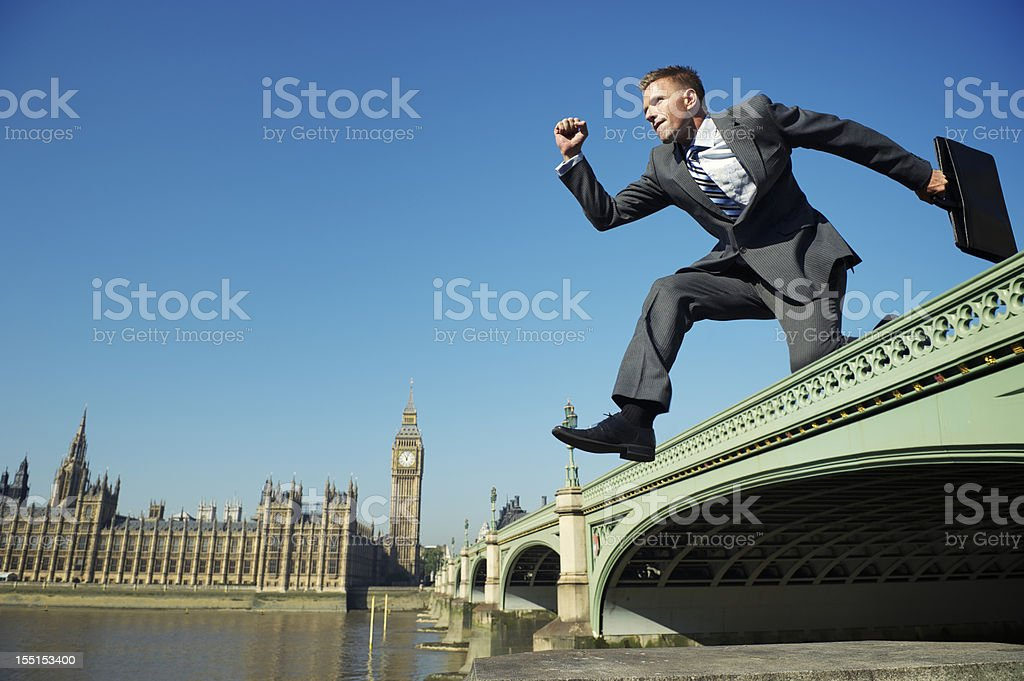 Businessman Leaps over Westminster Bridge London royalty-free stock photo