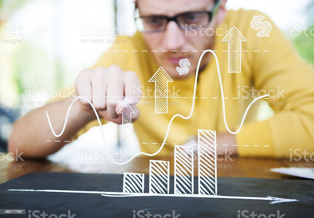 Businessman Learning the Graph with a Serious Face stock photo