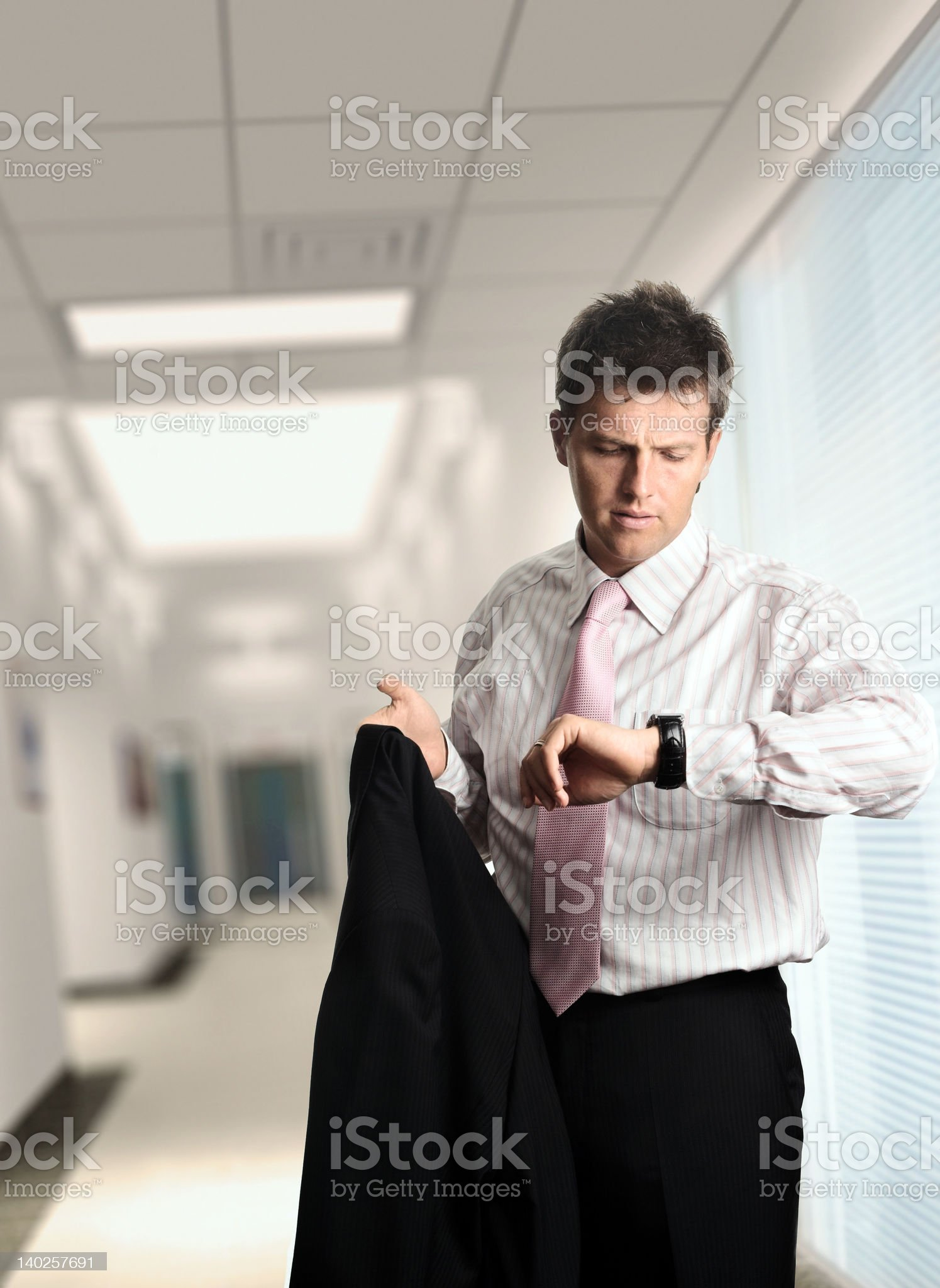 Businessman leaves the office royalty-free stock photo