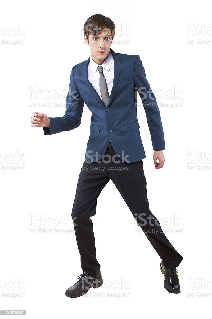 Businessman Leg Stuck From Something Pulling It stock photo