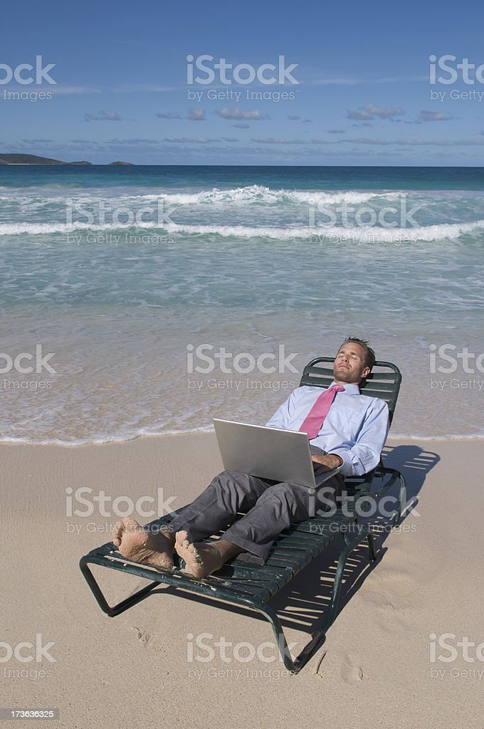 Businessman Lies Back w Laptop royalty-free stock photo