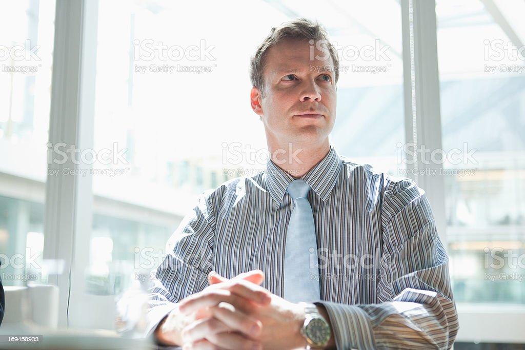Businessman listening in meeting stock photo
