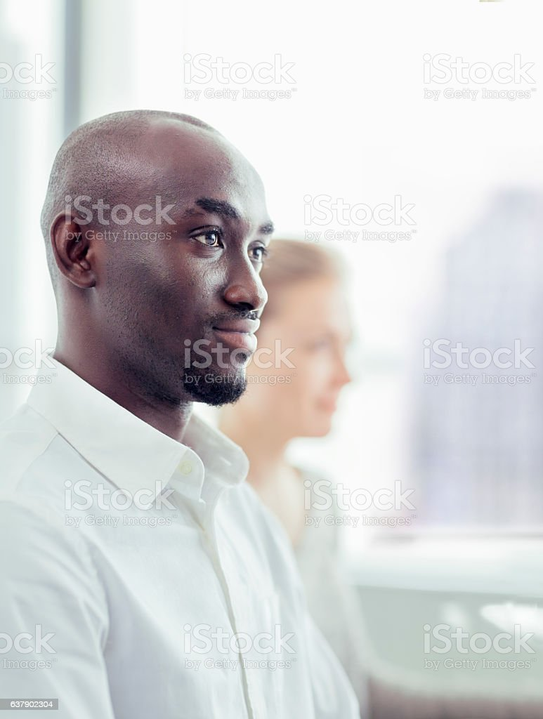 Businessman listening in office meeting stock photo