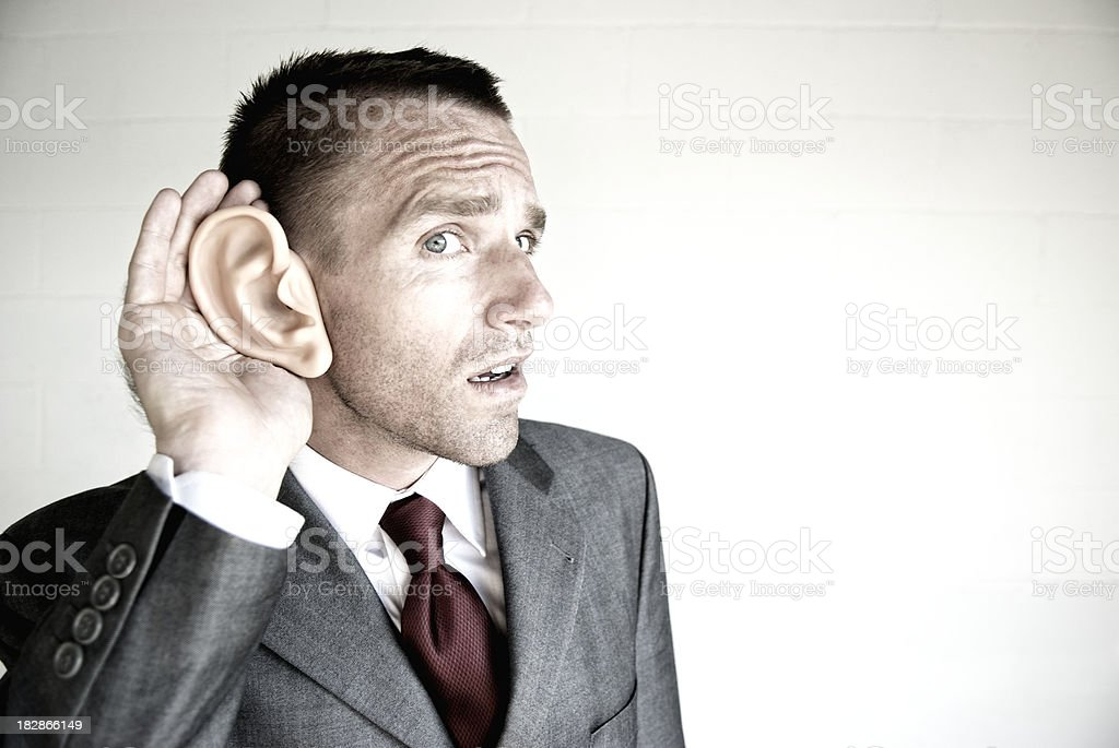 Businessman Listening with Big Ear White Background royalty-free stock photo