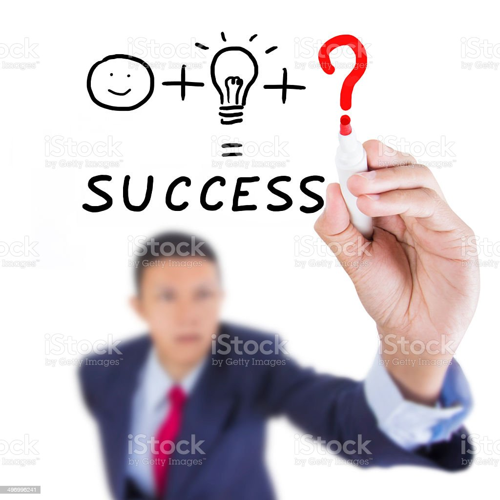Businessman look up and writing necessary thing for success stock photo