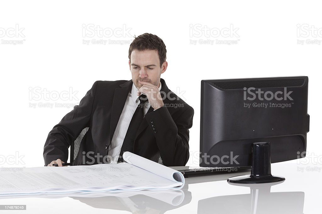 Businessman looking at a blueprint royalty-free stock photo