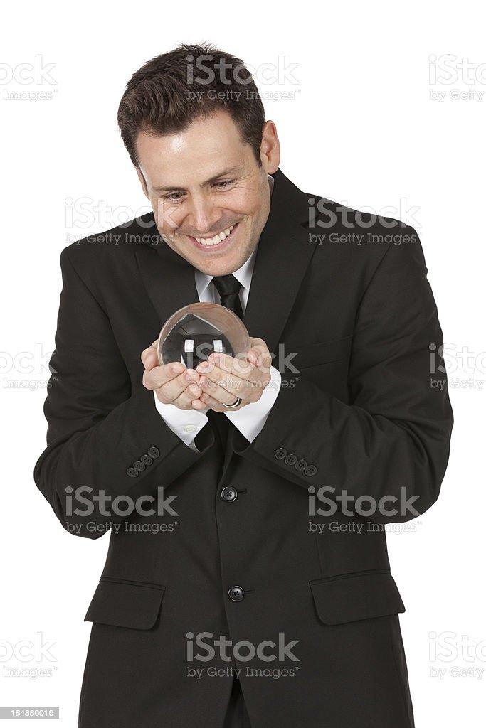 Businessman looking at a crystal ball stock photo