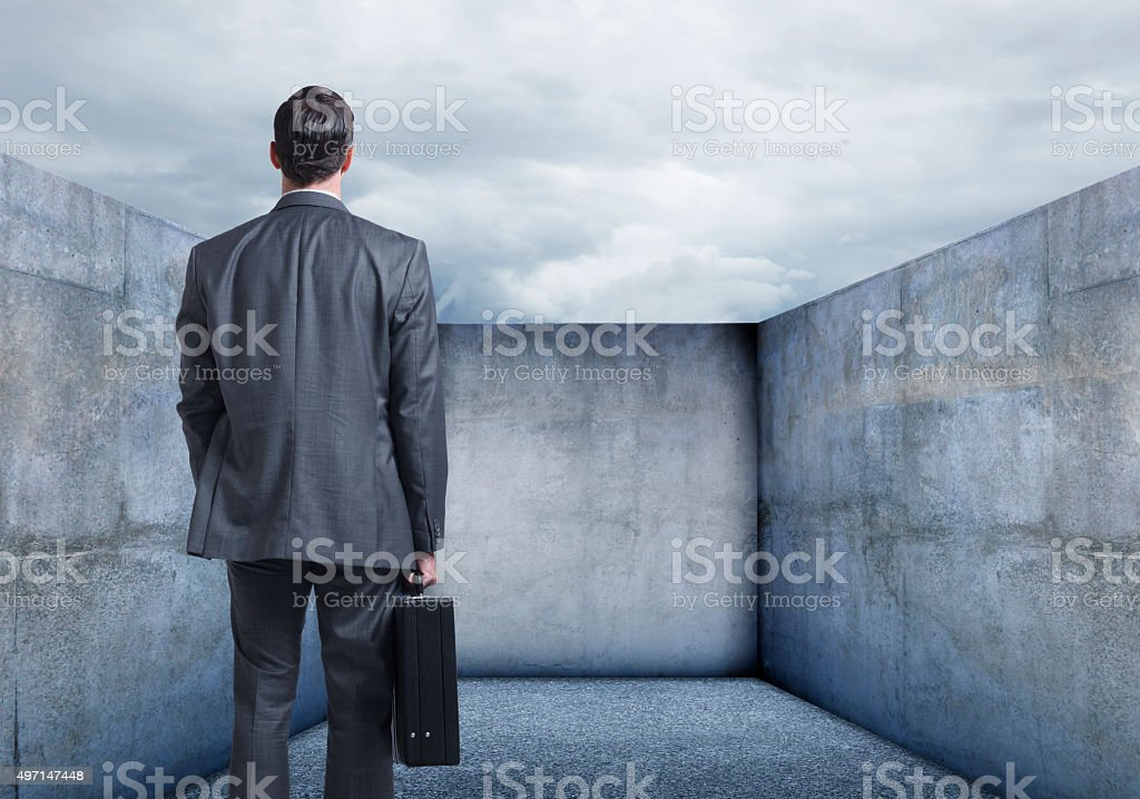 Businessman Looking At A Dead End stock photo