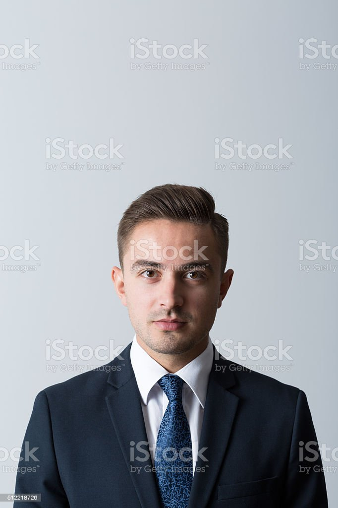 Businessman looking at camera stock photo