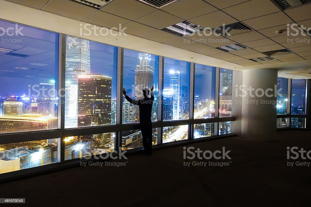 Businessman looking at cityscape night stock photo