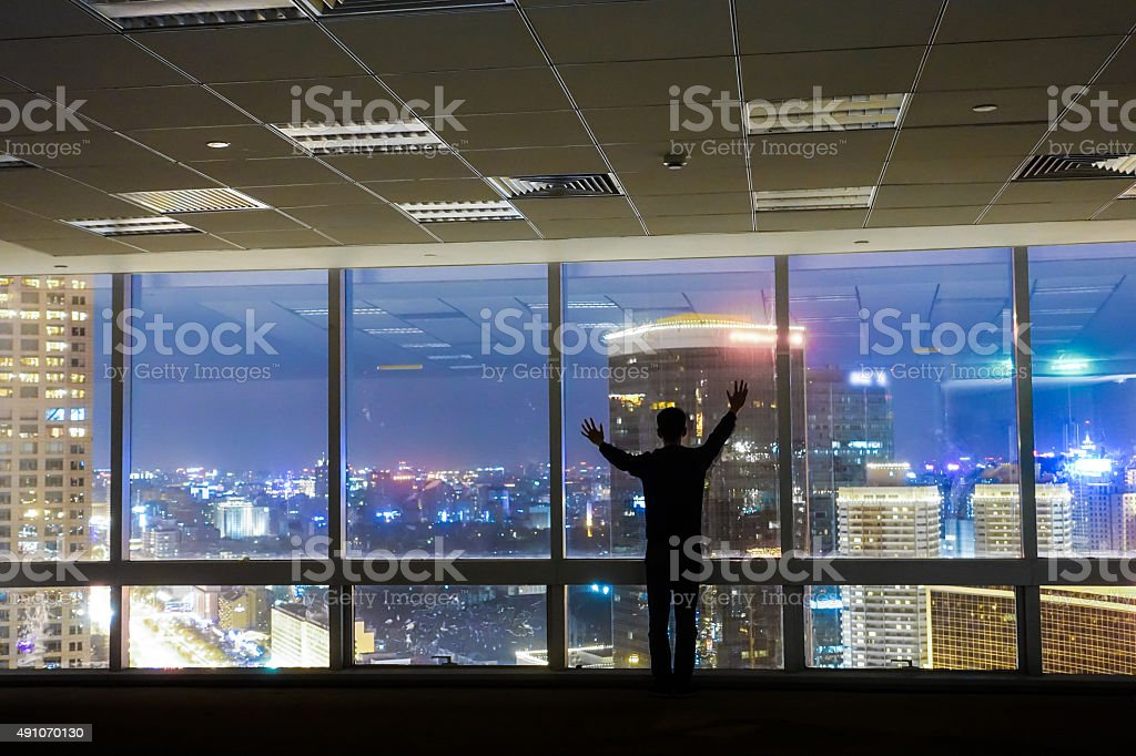Businessman looking at cityscape stock photo