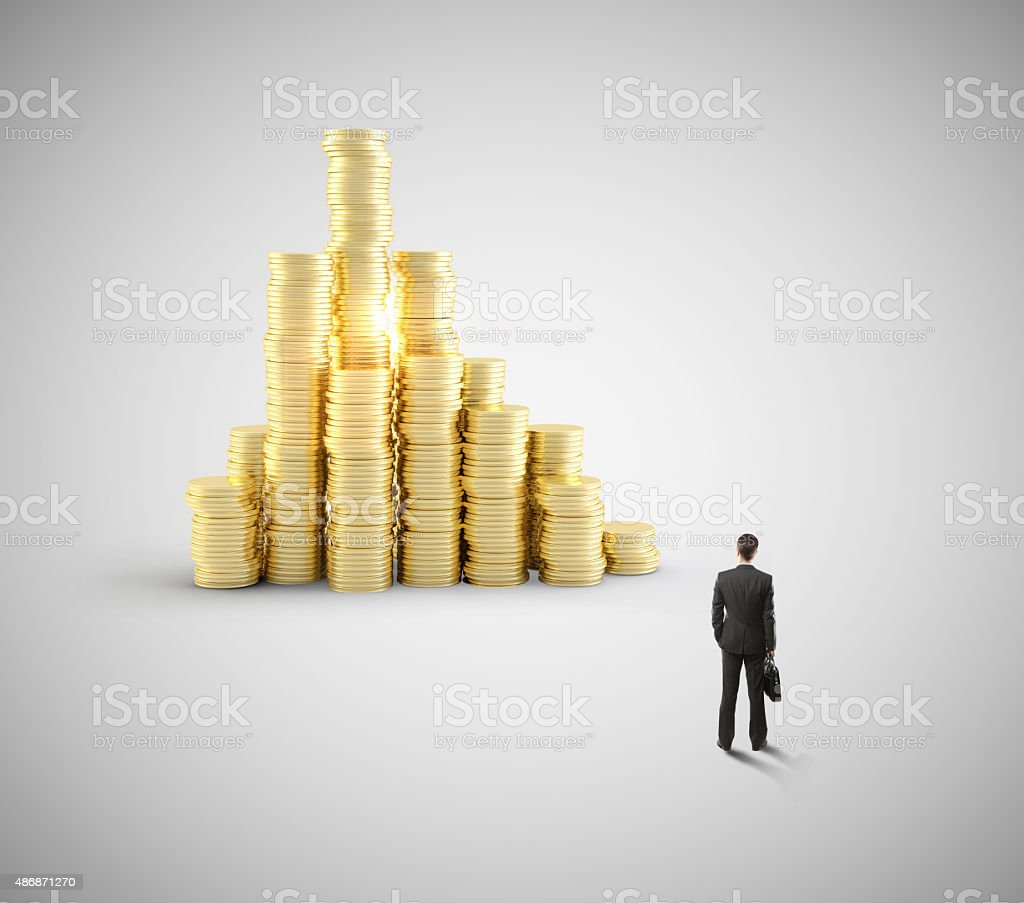 businessman looking at coin stock photo