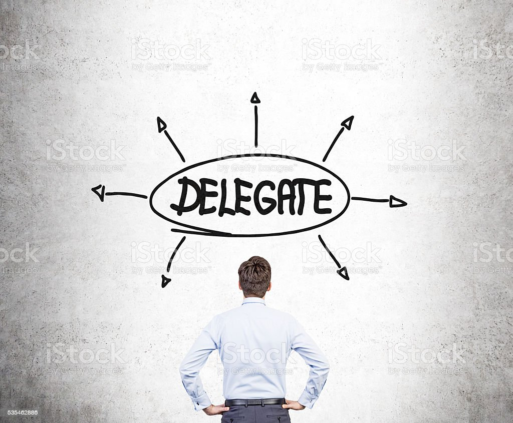 Businessman looking at delegate sketch stock photo