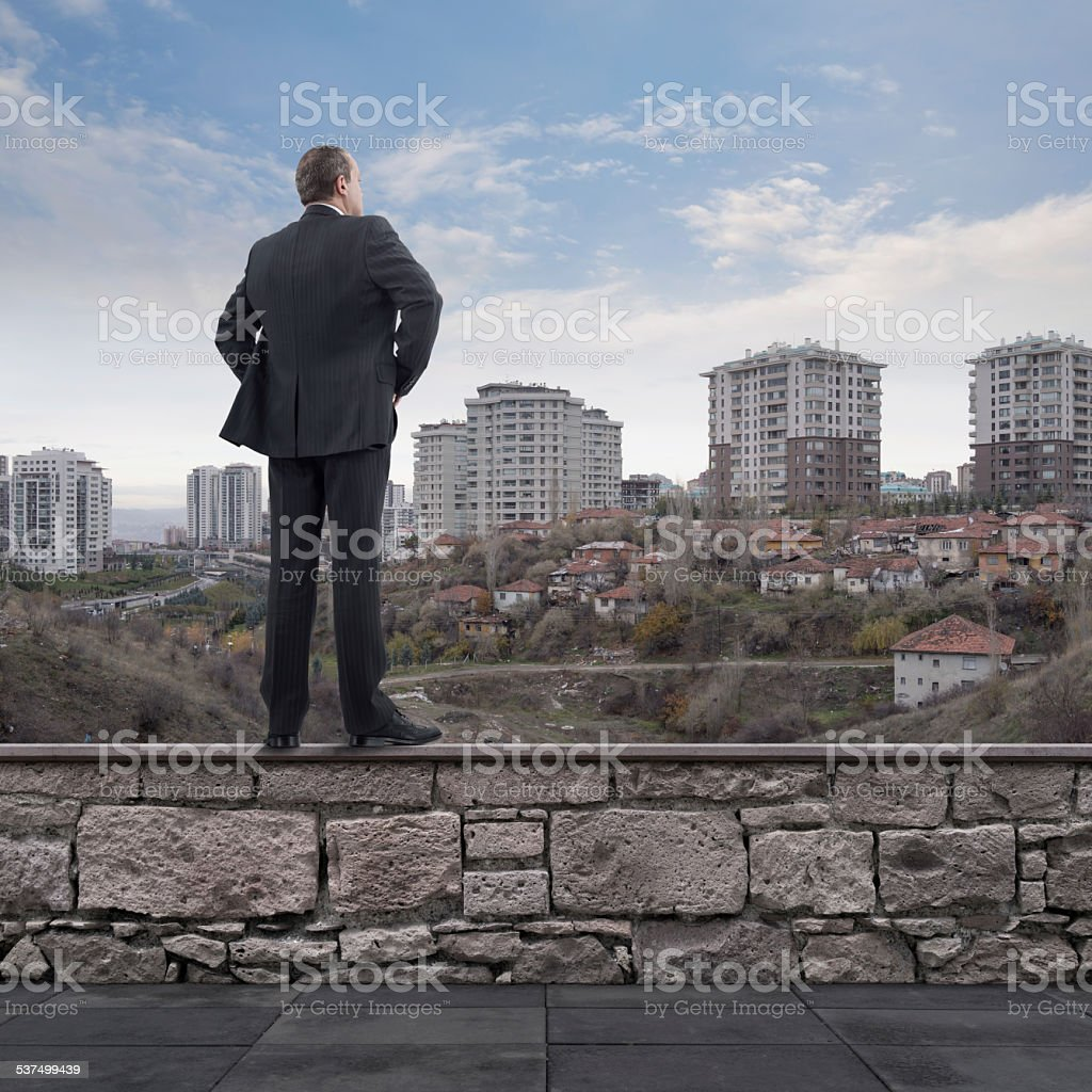 Businessman Looking at Developing City stock photo
