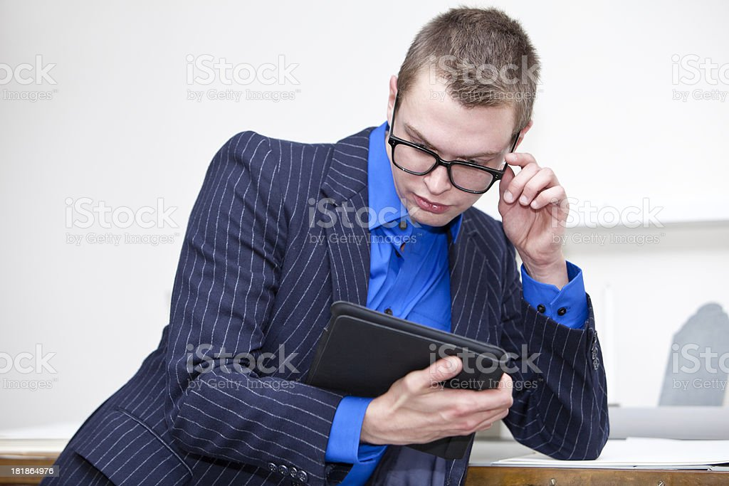Businessman looking at digital tablet stock photo
