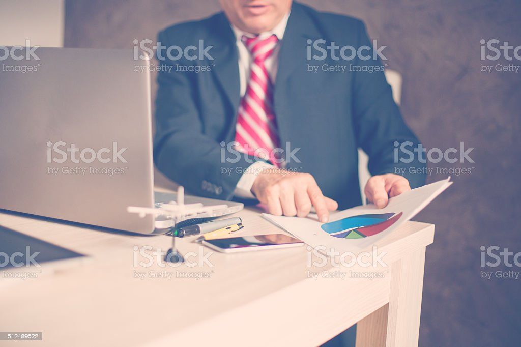 Businessman Looking At Document stock photo